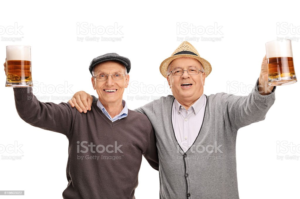 Two cheerful seniors holding pints of beer stock photo