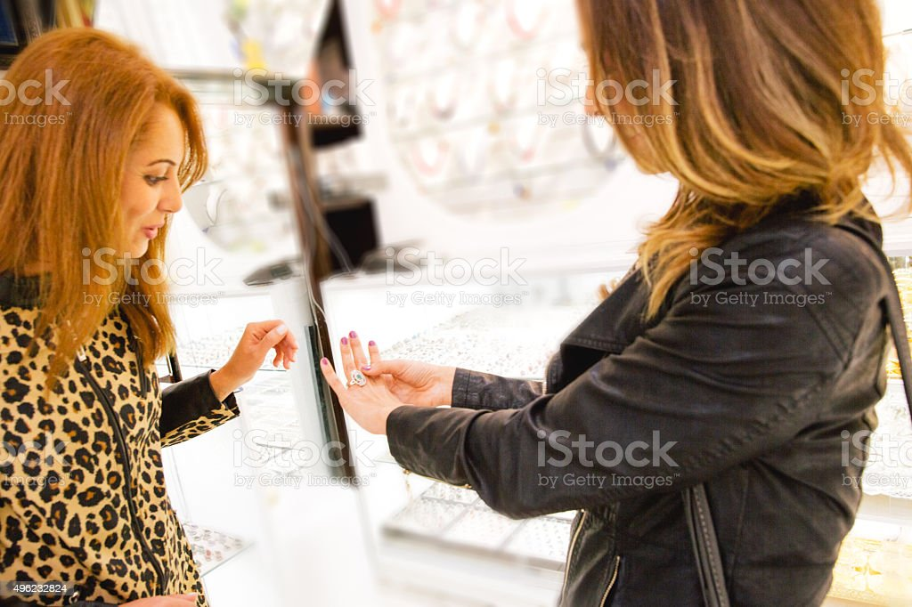 Two Cheerful Women In A Jewelry Store stock photo