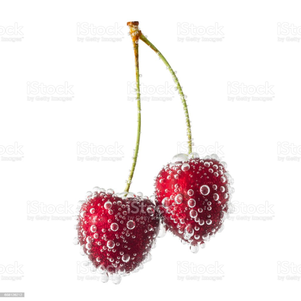 Two cherries covered with air bubbles isolated on a white background stock photo