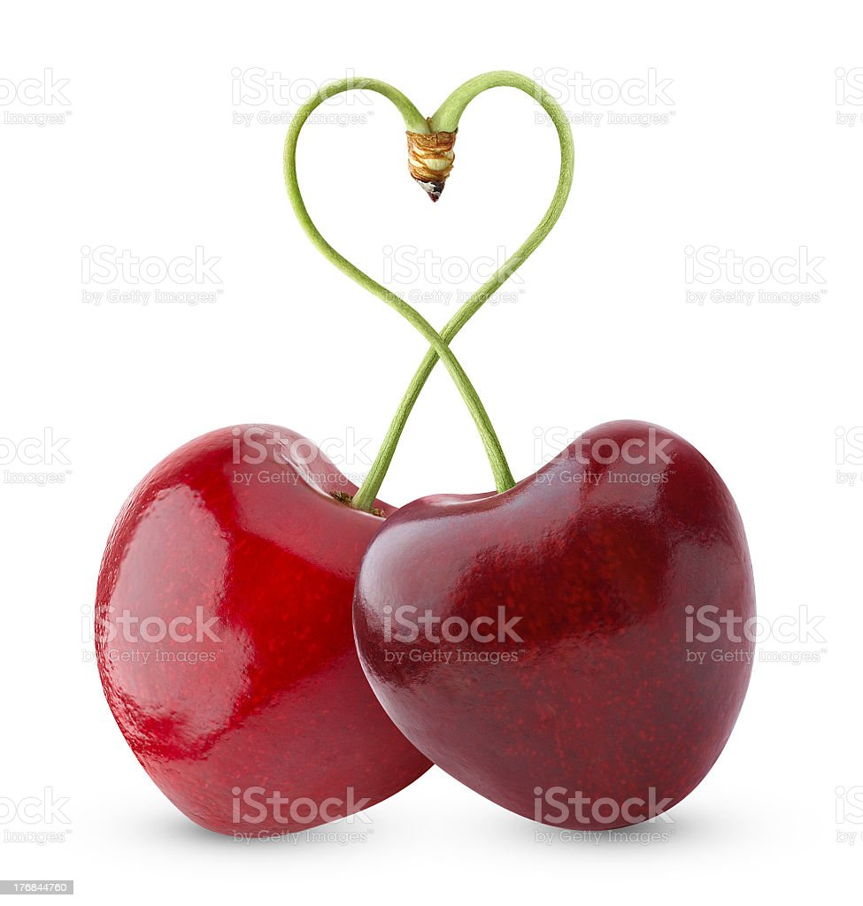 Two cherries with two tips forming a heart stock photo