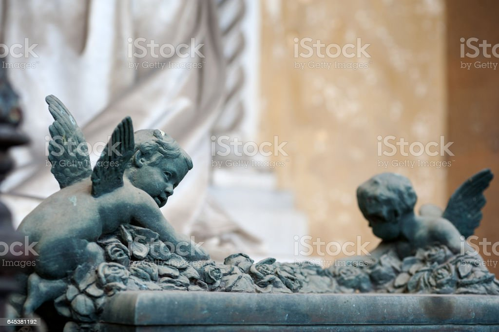 Two cherubs climb a full of roses altar stock photo