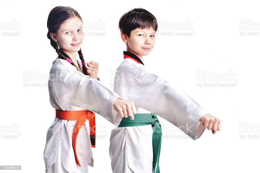 Two children athletes martial art taekwondo trainingTwo children...