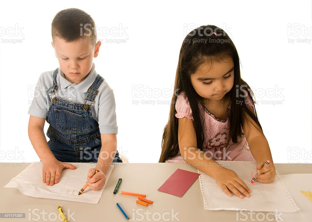 Two children coloring with crayons royalty-free stock photo