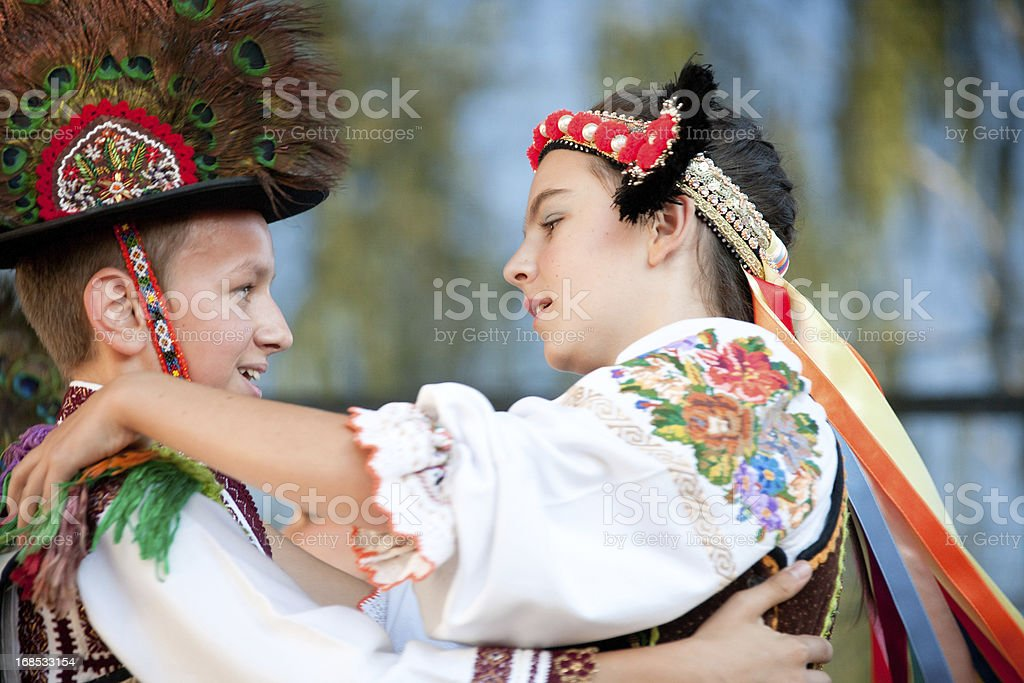 Two children dancing in traditional outfits stock photo