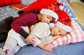 two children get sleepy till they await christmas