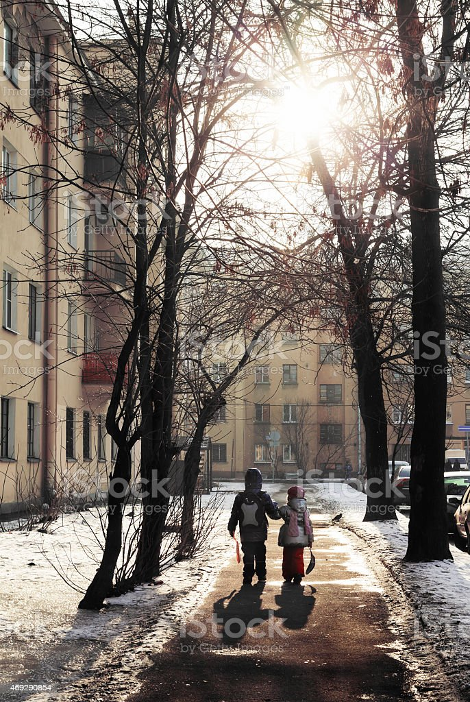 Two children in the city stock photo
