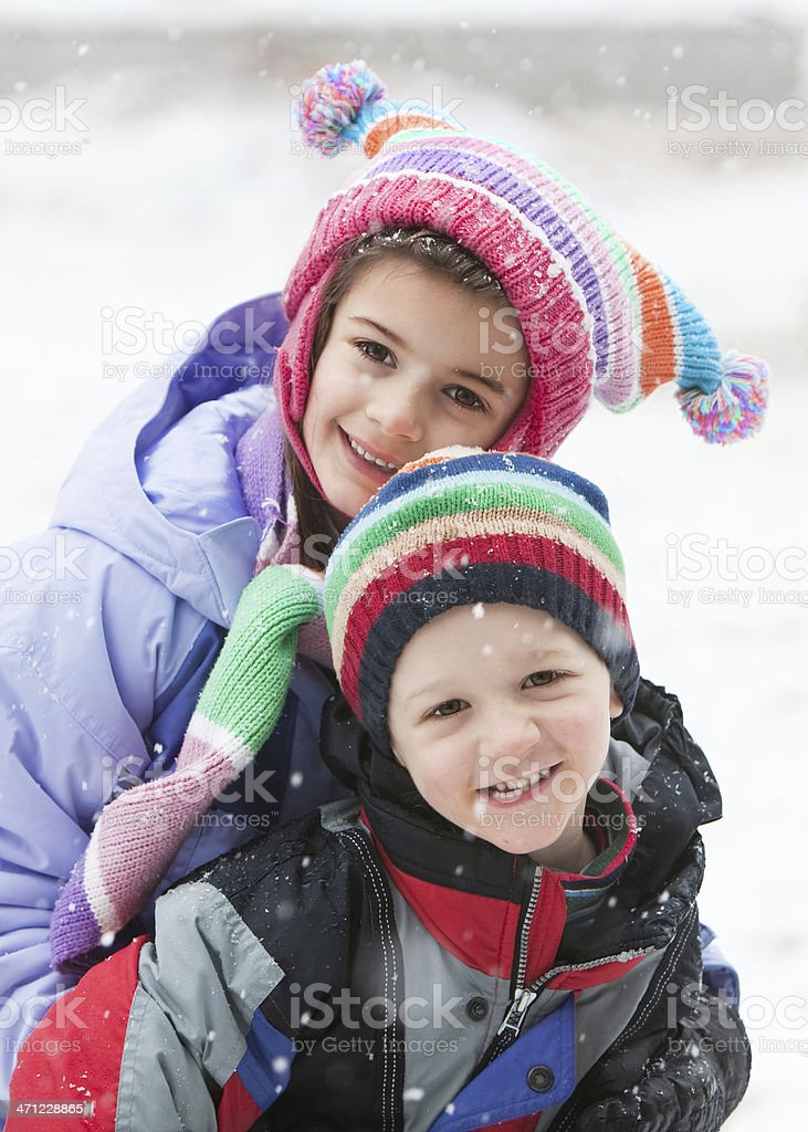 Two Children in the Snow with Knit Hats royalty-free stock photo