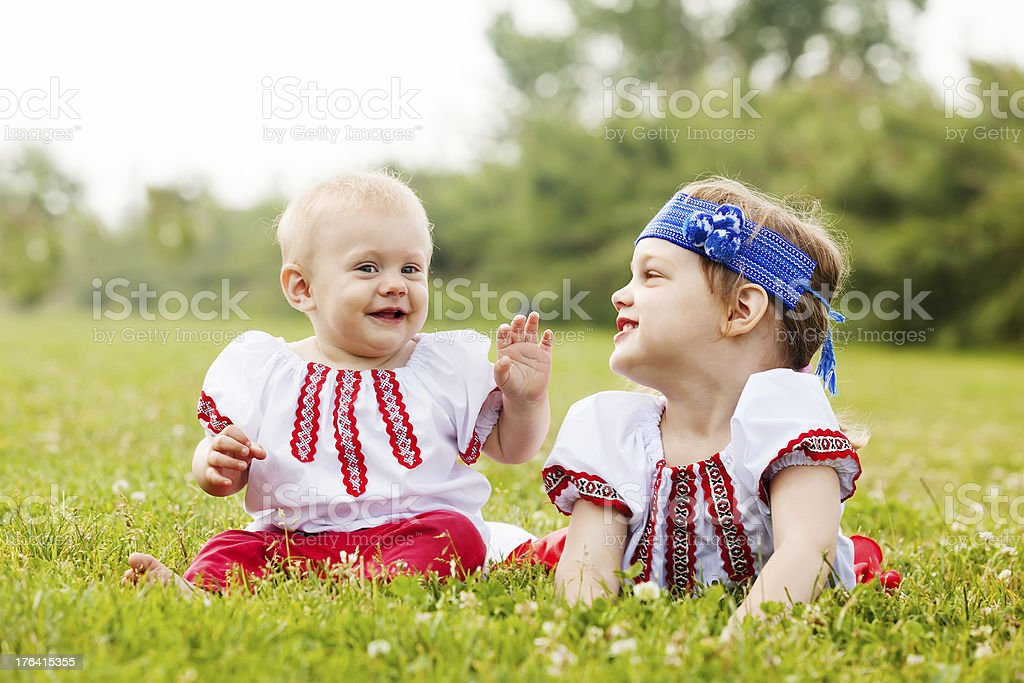 Two children in traditional folk clothes stock photo