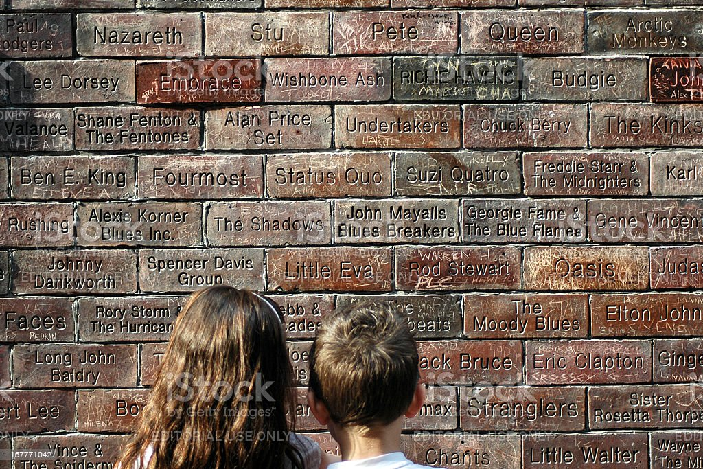 Two children looking at the Cavern Wall of Fame stock photo