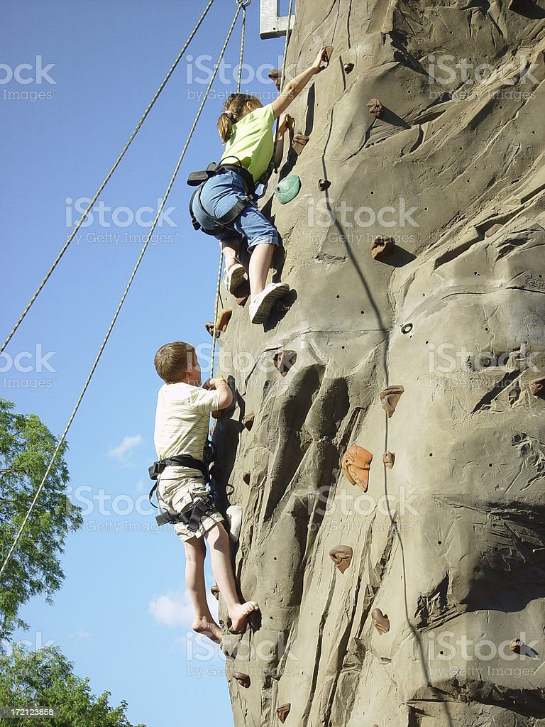 Two Children on Outdoor Climbing Wall royalty-free stock photo