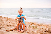 two children playing on beach