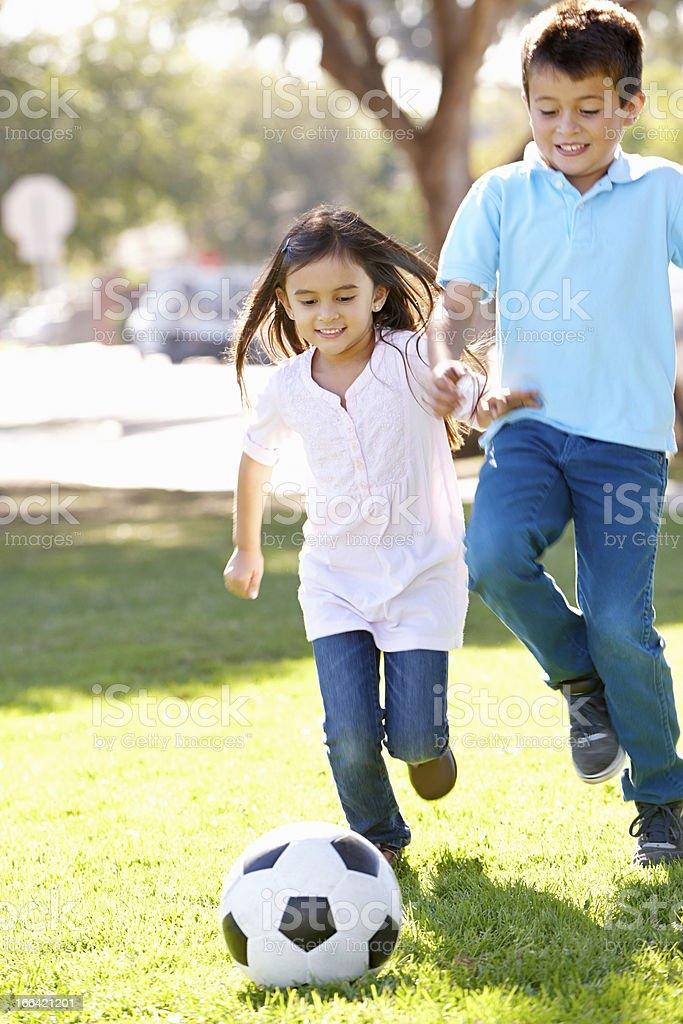 Two Children Playing Soccer Together stock photo