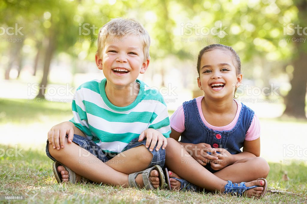 Two Children Playing Together In Park royalty-free stock photo