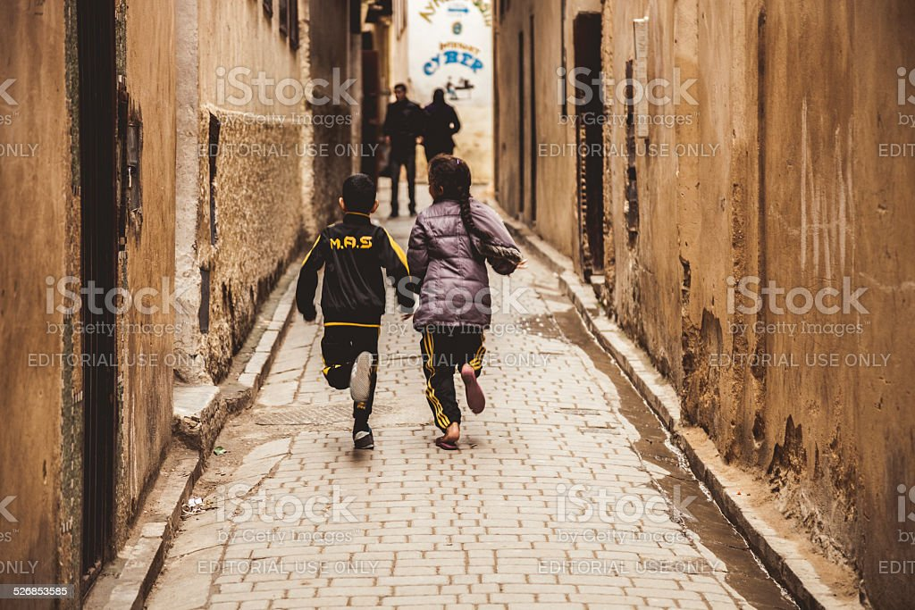 Two children plays in the Fez Medina stock photo