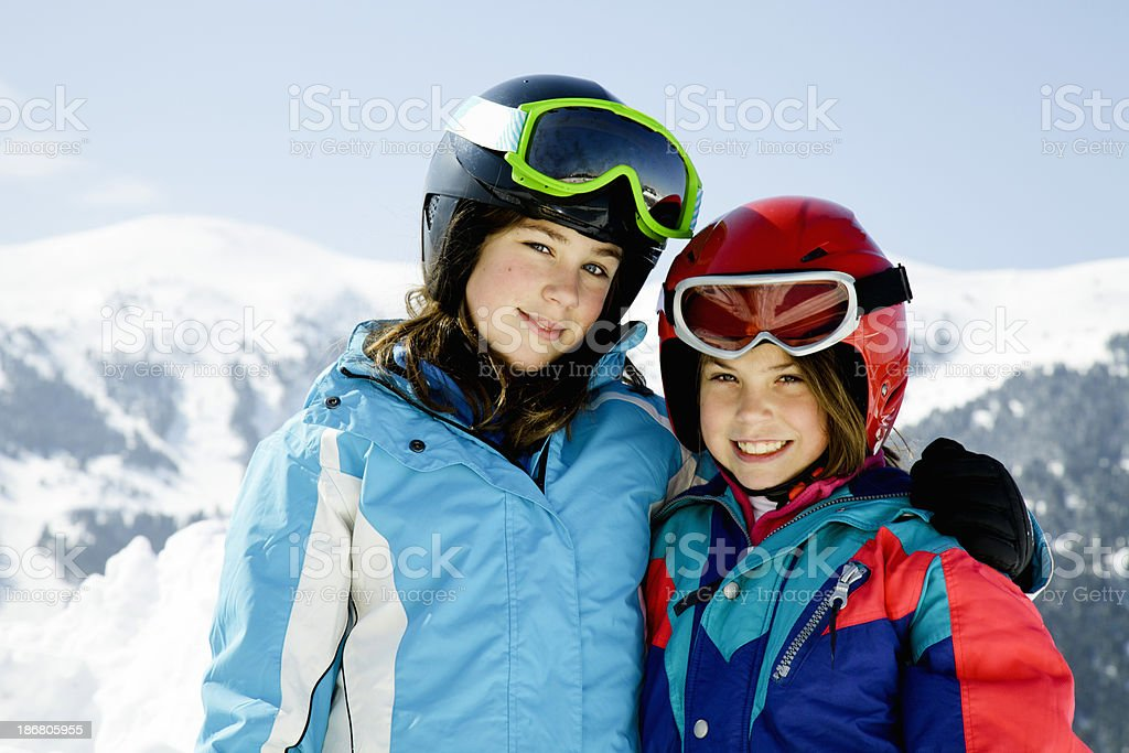 Two children skiers posing stock photo