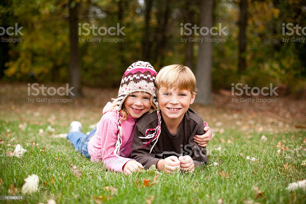 Two Children Smiling for Camera While Outdoors royalty-free stock photo