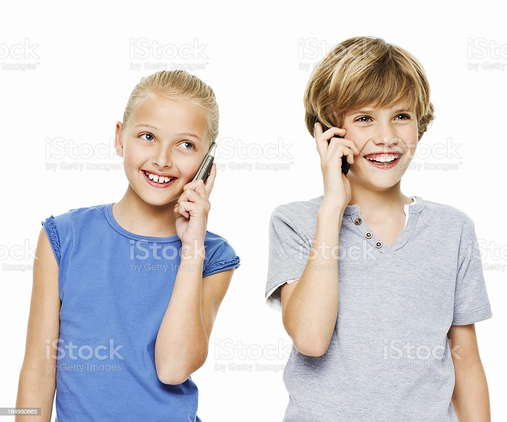 Two Children Talking on Cellphones - Isolated royalty-free stock photo