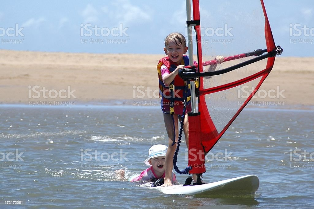 Two Children Windsurfing and having fun royalty-free stock photo
