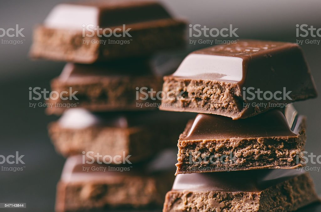 Two chocolate buildings on a dark background. energy and sugar. stock photo