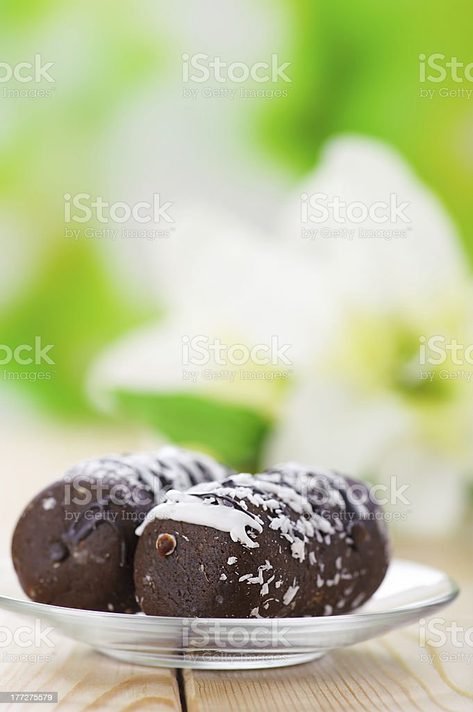 Two chocolate cakes with blooming lilies stock photo