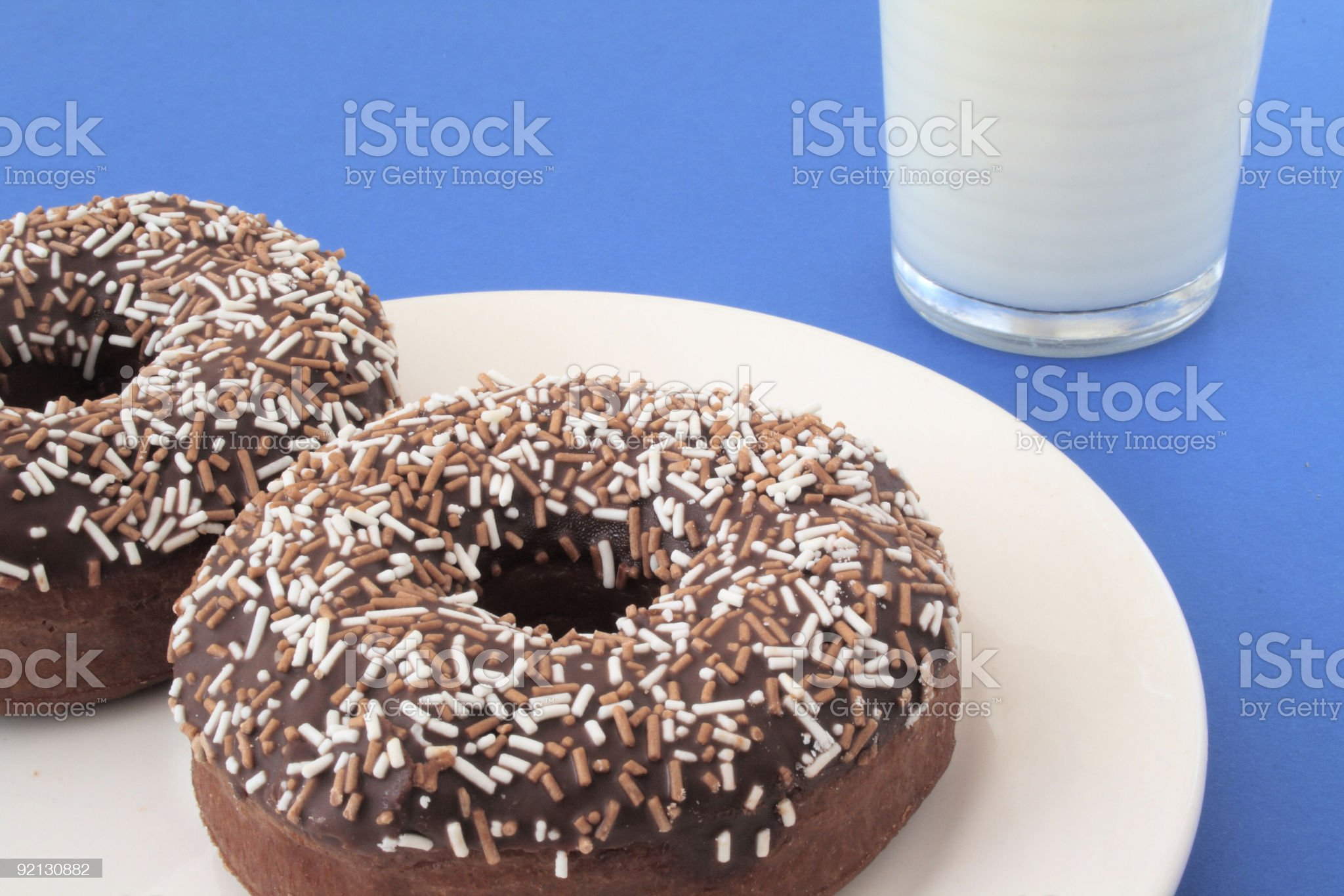 Two chocolate donuts and a glass of milk royalty-free stock photo