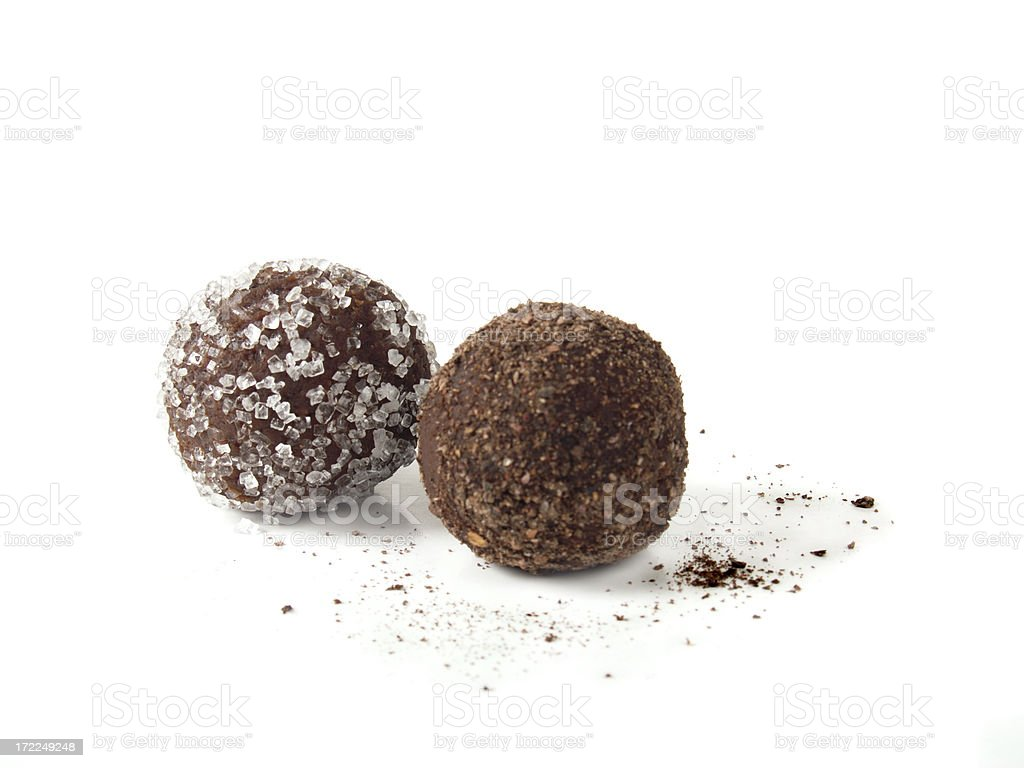 Two Chocolate truffles on white background stock photo