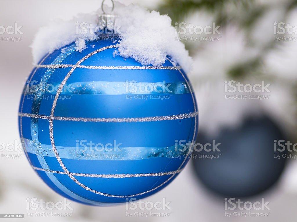 Two Christmas balla with snow stock photo