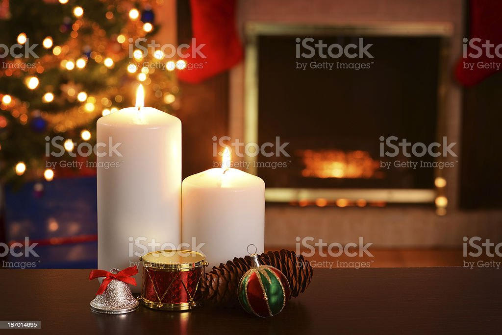 two christmas candles focus on flame shallow DOF royalty-free stock photo