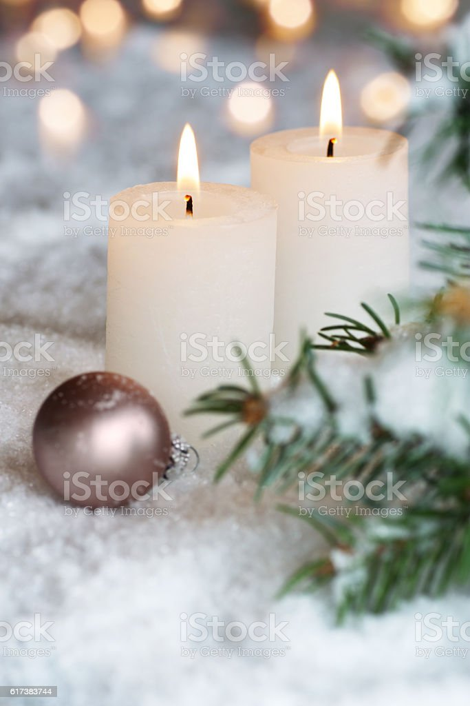 Two Christmas candles in the snow stock photo
