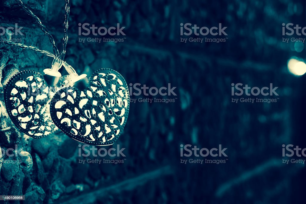 Two Christmas Light, with Stone Wall Background stock photo