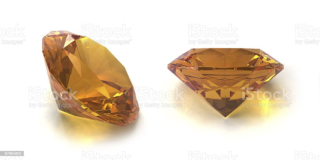 Two Citrine gems at different angles on white background stock photo