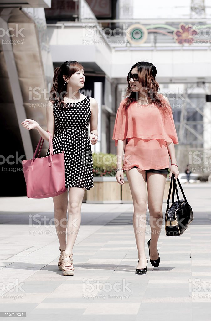 two city young women walking with bag  in the street royalty-free stock photo