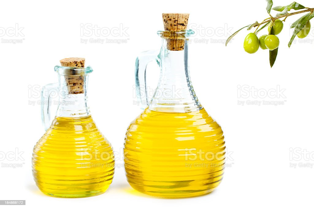 Two clear bottles filled with olive oil royalty-free stock photo