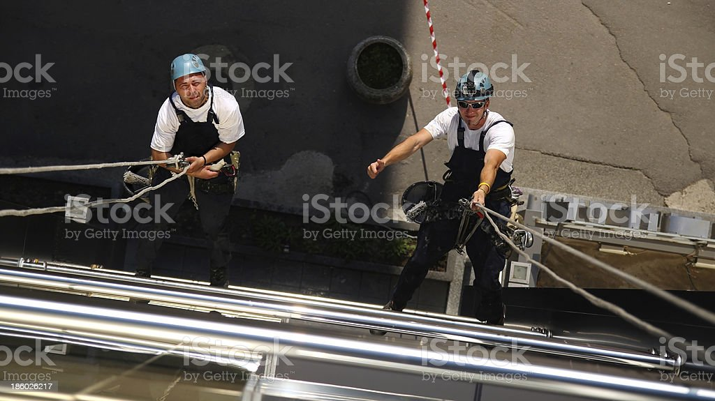 Two Climbers Working on Heights stock photo