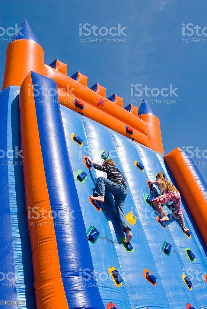 two climbing children stock photo