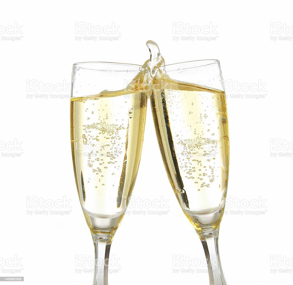 Two clinking glasses of champagne royalty-free stock photo