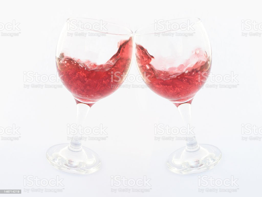 Two clinking glasses with red wine royalty-free stock photo