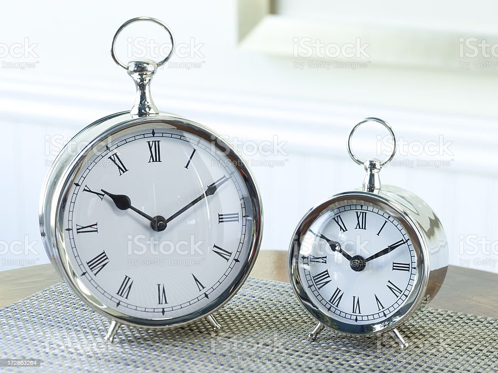 Two clocks on a table royalty-free stock photo