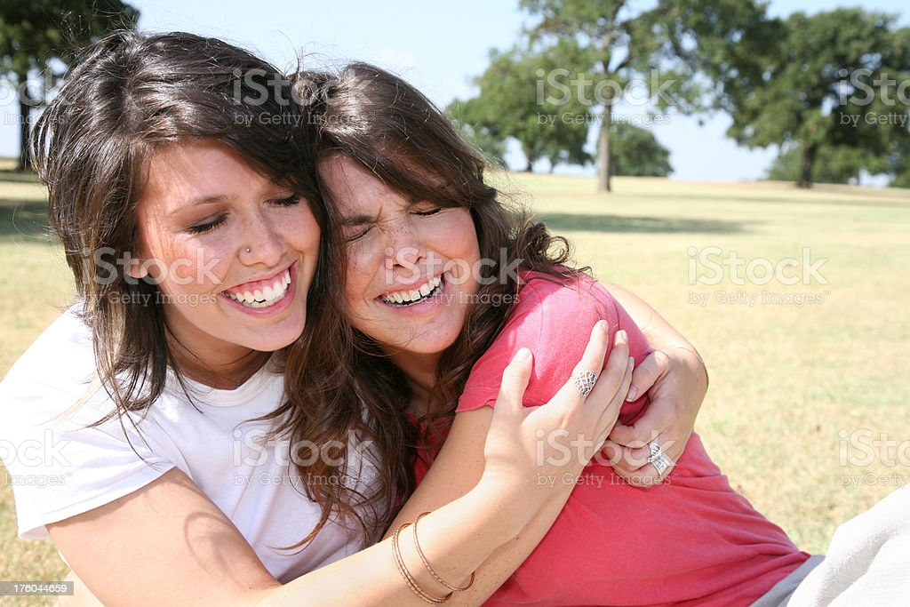 Two Close Girls Happily Crying Together royalty-free stock photo