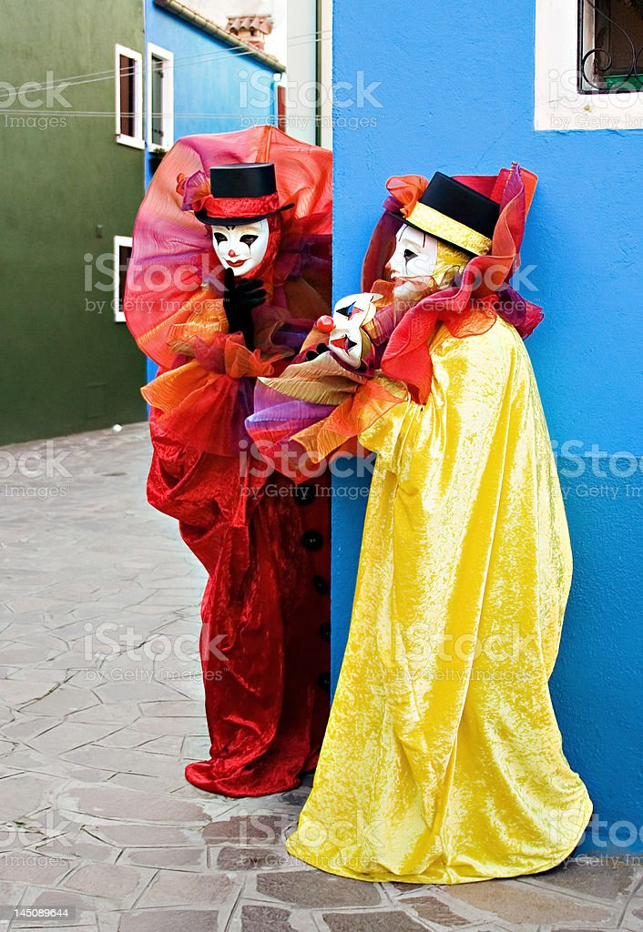 Two clowns in mask performing royalty-free stock photo