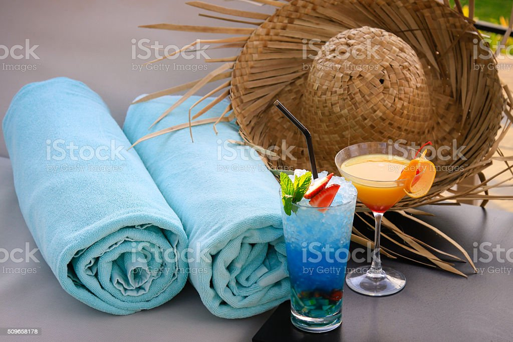 two cocktails and straw hat stock photo