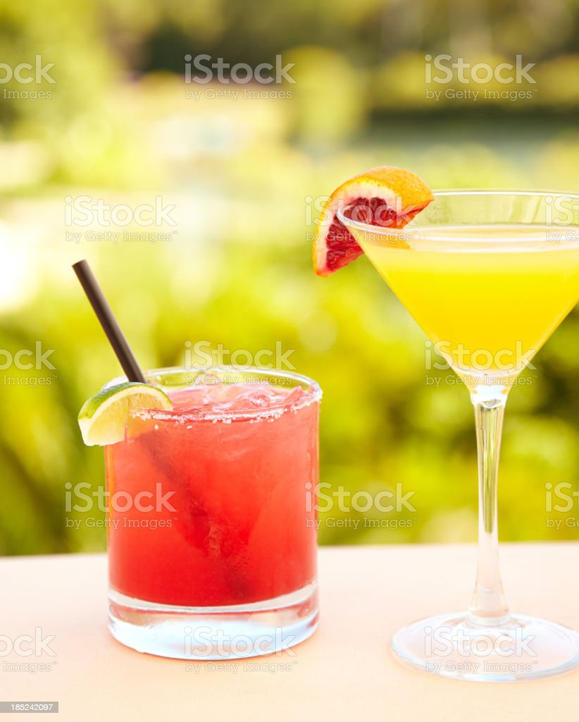Two cocktails at outdoor bar stock photo