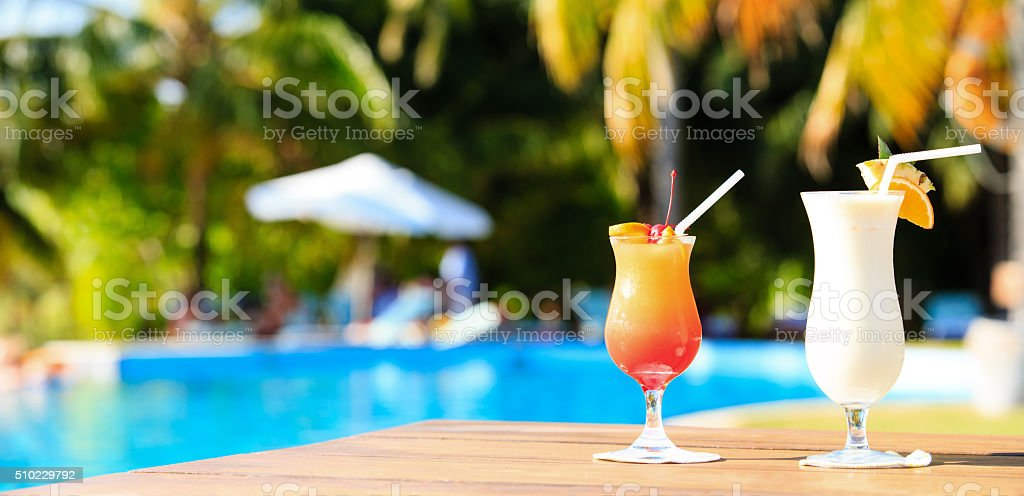 Two cocktails on luxury tropical beach resort, panorama stock photo