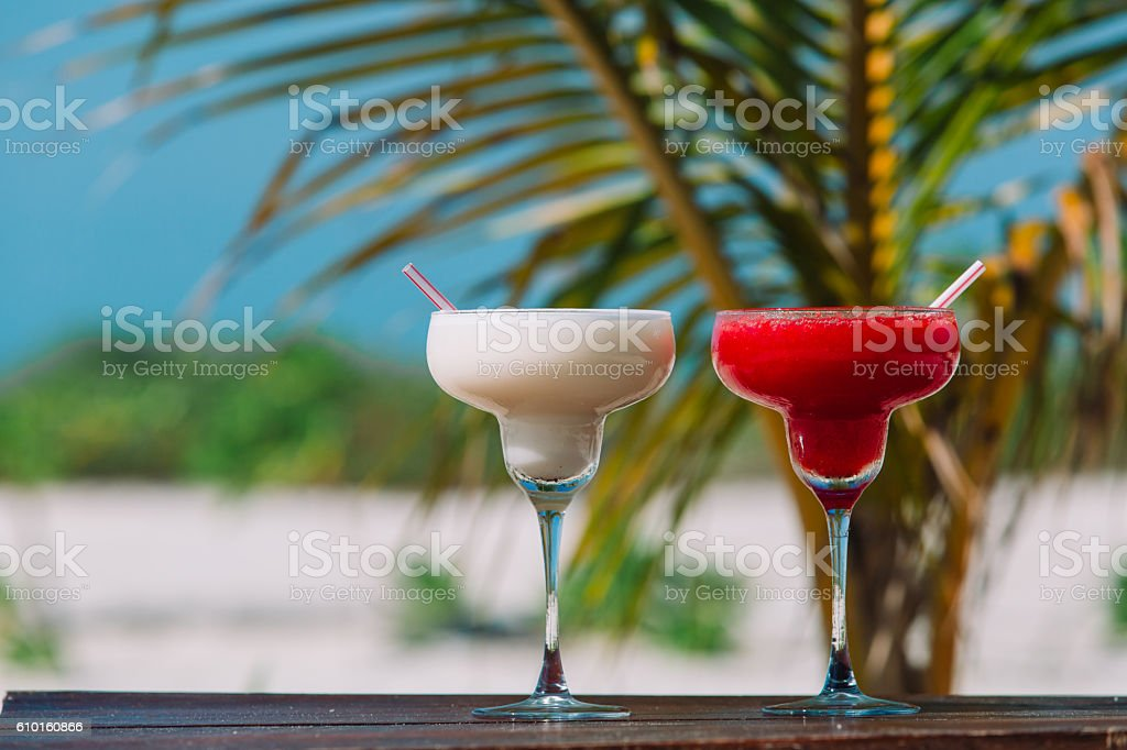 Two cocktails on luxury tropical sand beach stock photo