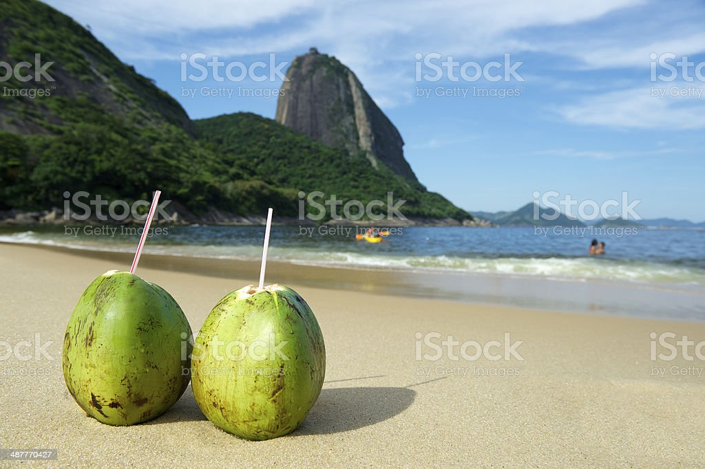 Two Coco Gelado coconuts at Red Beach in Brazil stock photo