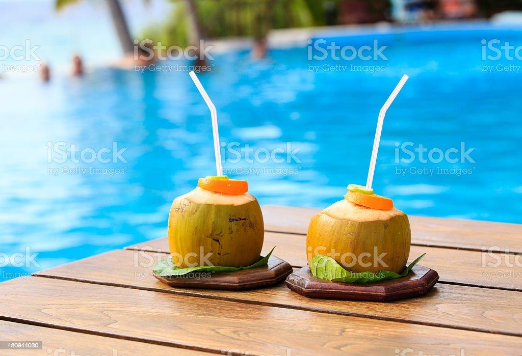 two coconut drinks in luxury resort stock photo