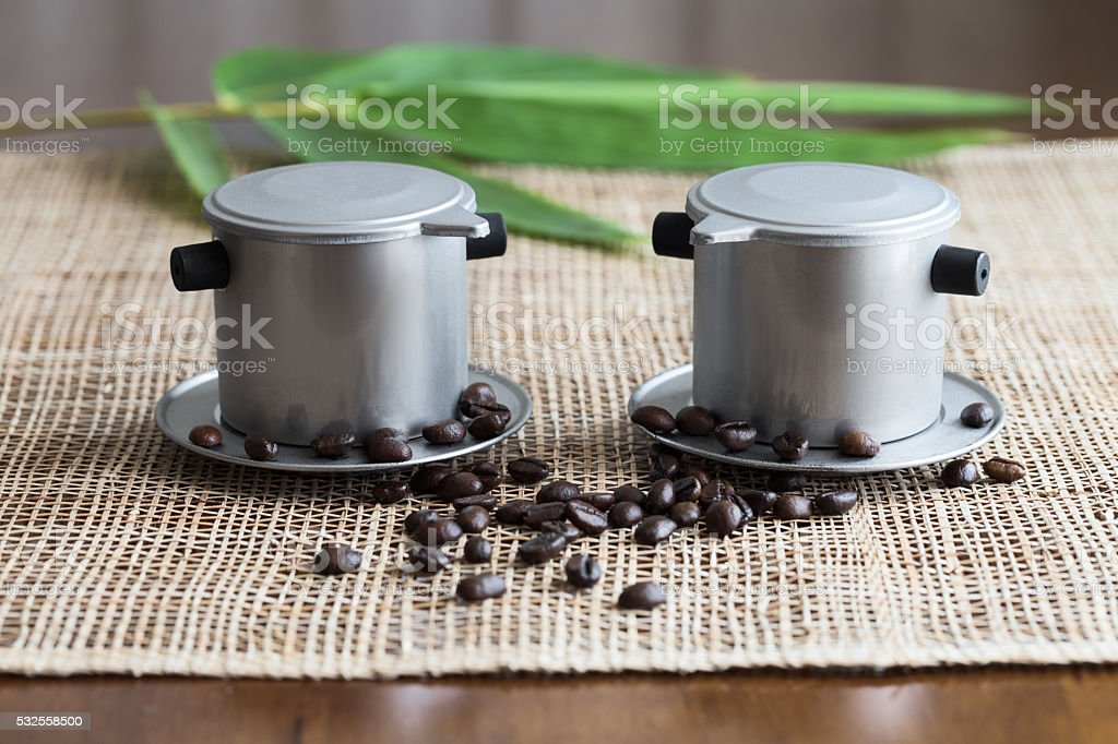 Two coffee makers on placemat. Vietnam style stock photo