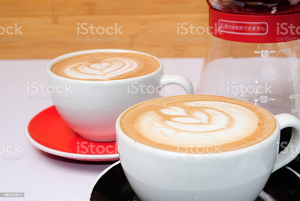 two coffes and coffe machine wood stock photo