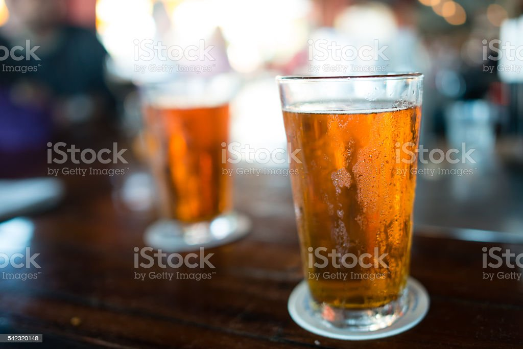 Two cold beers on a bar stock photo