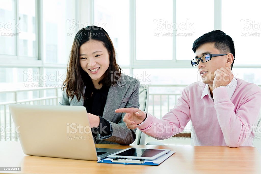 Two colleagues at work stock photo